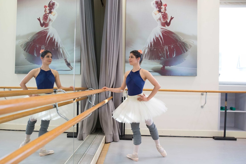 Ella Havelka looks in mirror at dance studio, pictured in story about successful Australians who have experienced disadvantage.