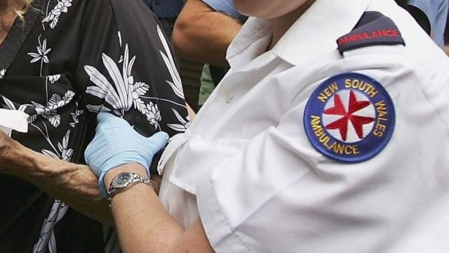 nsw ambulance officer helps a patient; generic logo thumbnail