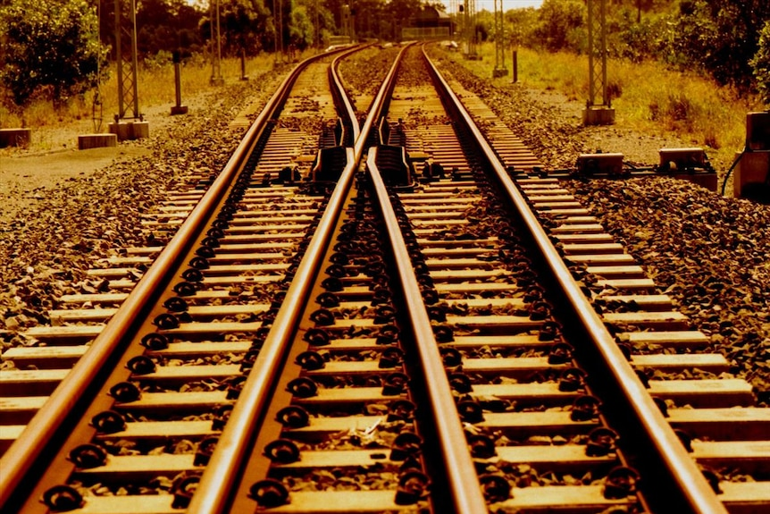 Close up of train tracks which go off in the distance.