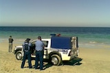 Police at the scene of a suspected shark attack at Port Kennedy, south of Perth.