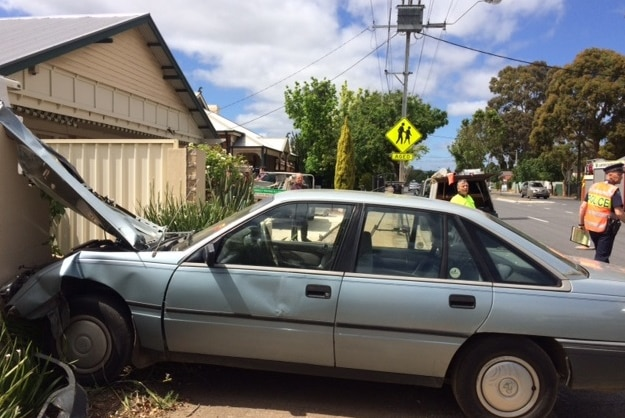 Emergency services in Payneham South after a car crashes into a house