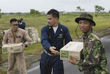Sailors from the USS Abraham Lincoln load a truck with supplies to be distributed in Indonesia