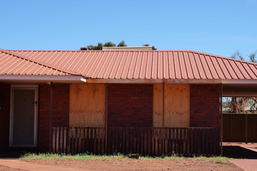 An image of a boarded up property in Newman.