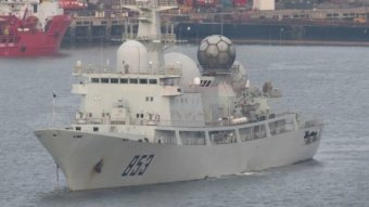 A Chinese AGI spy ship floats in a harbour.