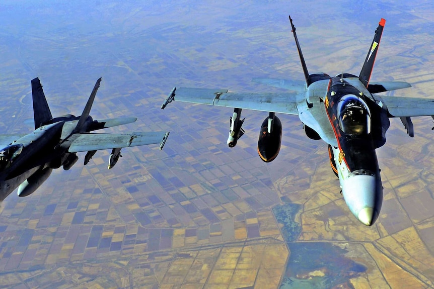 Two US fight jets fly over fields in Iraq