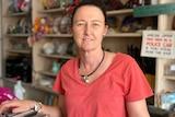 A smiling woman in bric-a-brac shop at Cobar