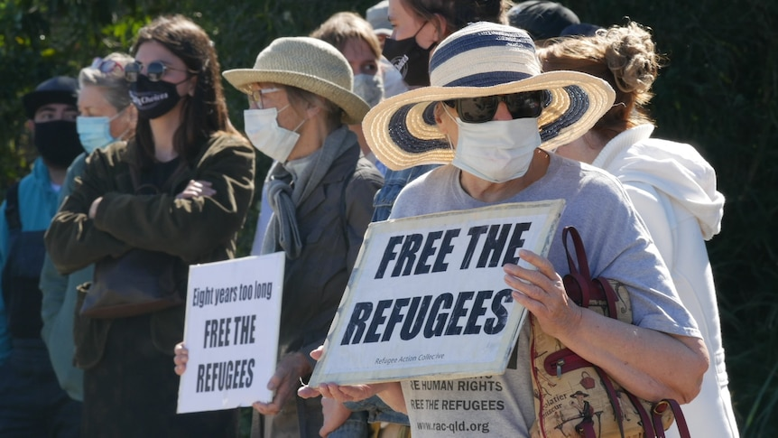 Refugee advocates protest outside Brisbane immigration centre to mark nine years of indefinite detention