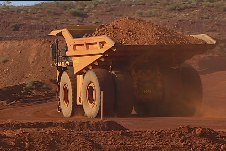 Giant mining truck carries ore in the Pilbara. April, 2014.