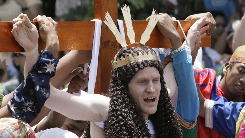 Stations of the cross: John Safran hangs on the cross in the Philippines.