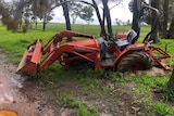 a bogged tractor in a field