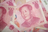 Red 100 yuan note of China's Renminbi currency with the late Chairman Mao's face.