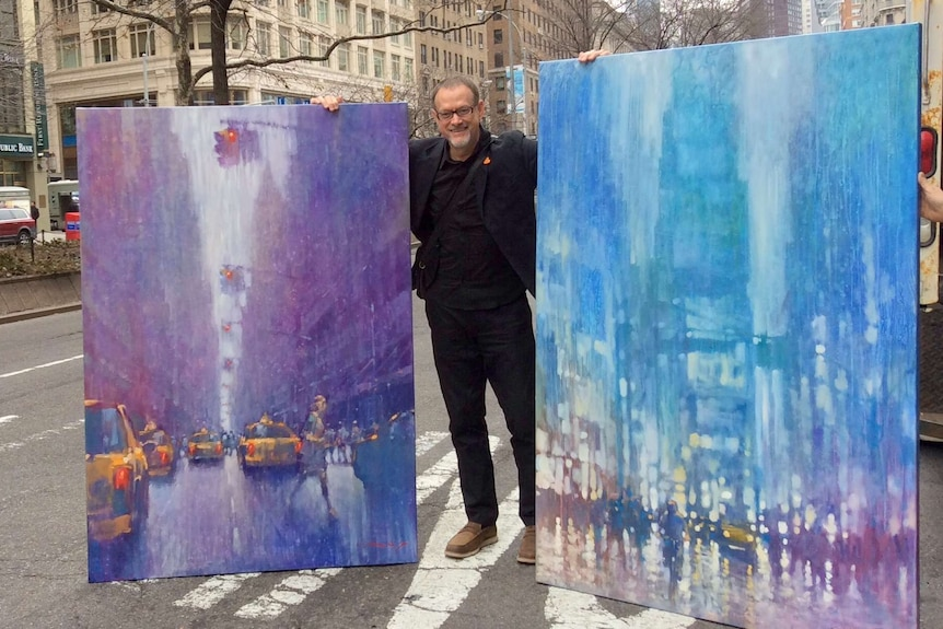 David Hinchliffe with paintings