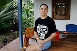 Law student Mililma May sits at her house in Darwin.