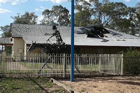 A building with multiple panels torn off the roof.
