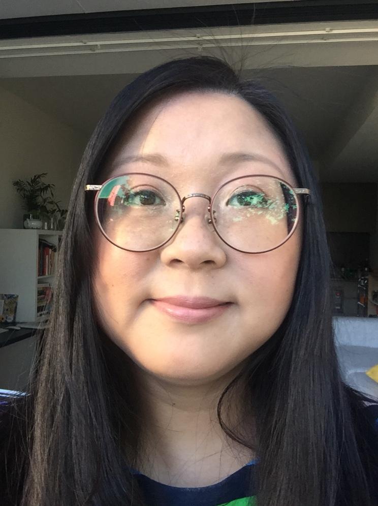 A selfie of Jennifer Wong with makeup.