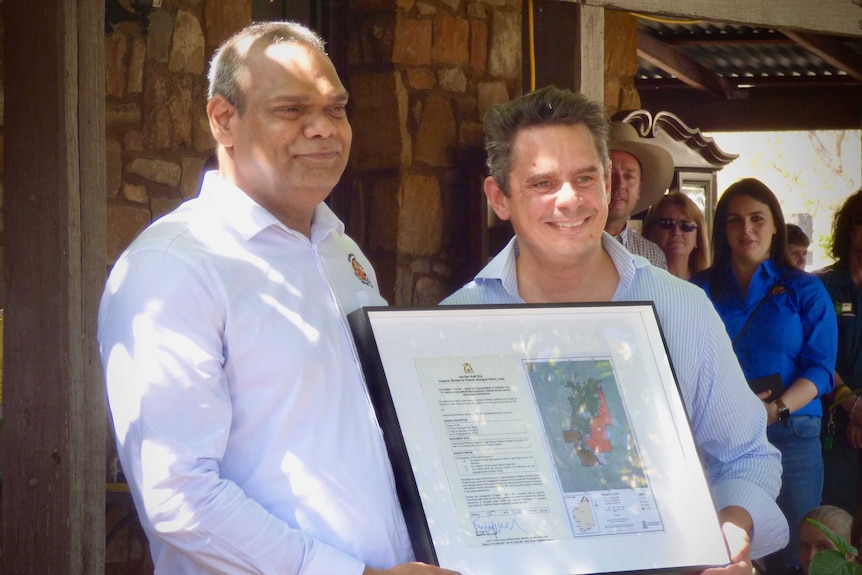MG Corporation executive chairman Lawford Benning with Lands minister Ben Wyatt hold Statement of Intent