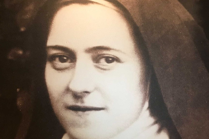 Black and white photograph of a nun