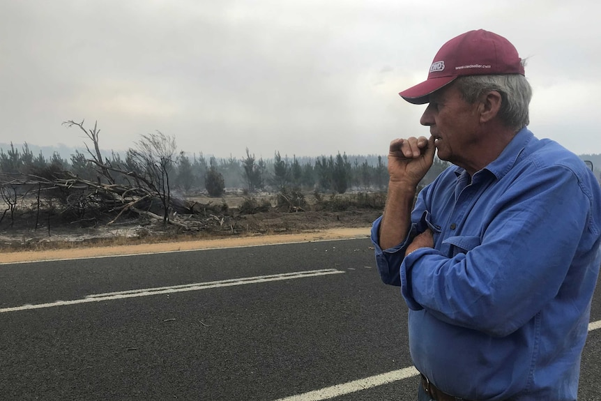 Richard Cooke surveys the damage after a fire in Victoria.
