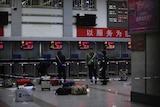 Police at Chinese train station after attack