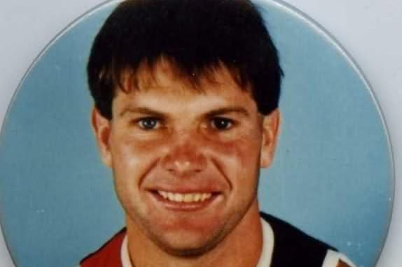 A young Danny Frawley, in a St Kilda guernsey, on a pin.