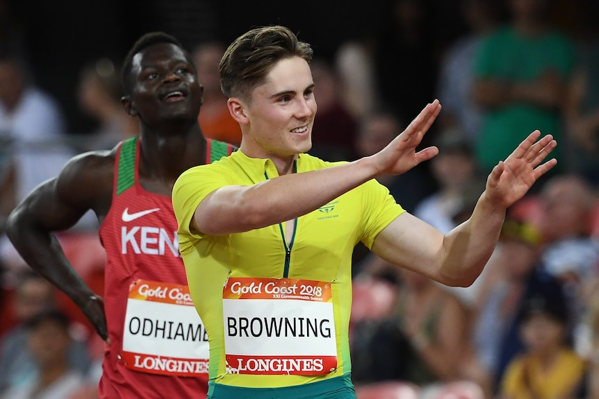 Rohan Browning waves to the crowd from the running track.