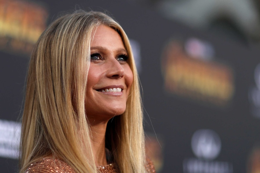Actress Gwyneth Paltrow smiles on the red carpet at the movie premiere
