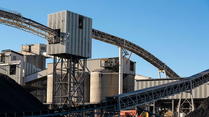 Above ground mine operations including ramps and conveyor belts