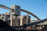 Above ground mine operations including ramps and conveyor belts.