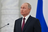 Vladimir Putin stands at an awarding ceremony in Moscow.