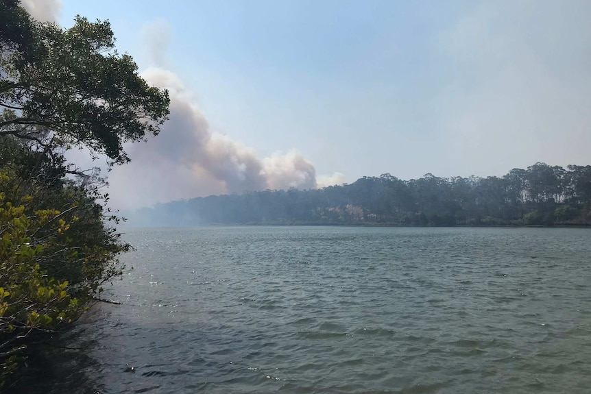 Fire seen in the distance across the water at Baffle Creek