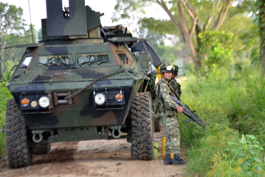 AColombian soldier stands guard in the town of Tame, Arauca department.