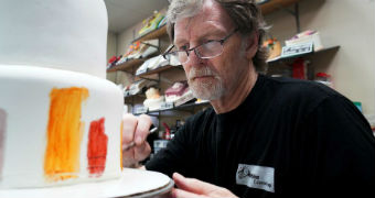 Baker Jack Phillips decorates a cake in his Masterpiece Cakeshop in Lakewood, Colorado