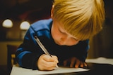 A young boy writes a letter to Santa