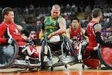 Australia's Ryley Batt (C) and Canada's Zak Madell (L) in 2000 Paralympics Wheelchair Rugby final.