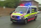 Ambulance driving along a road.