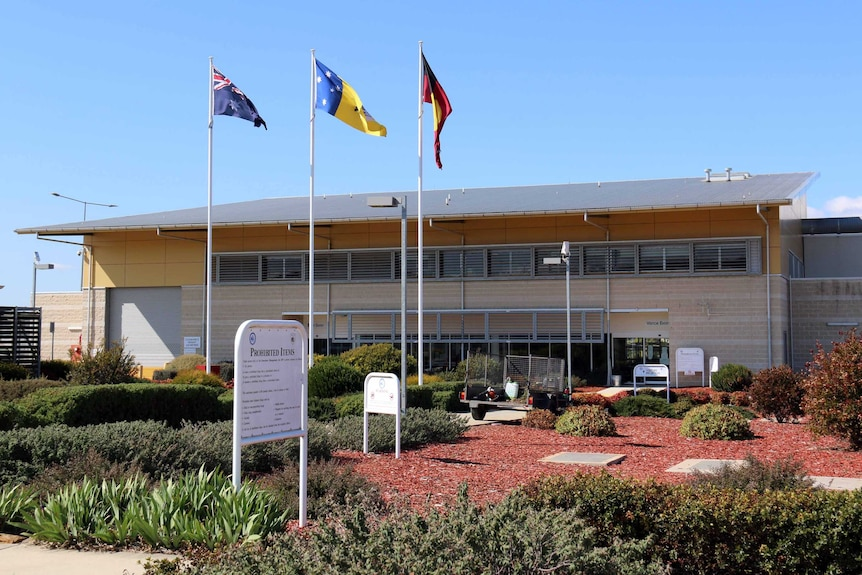 The exterior of the Alexander Maconochie Centre on a sunny day.