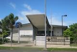 A country police station beneath a sunny sky.