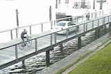 Surveillance camera footage shows the allegedly drunk and unlicensed woman driving down the boardwalk.