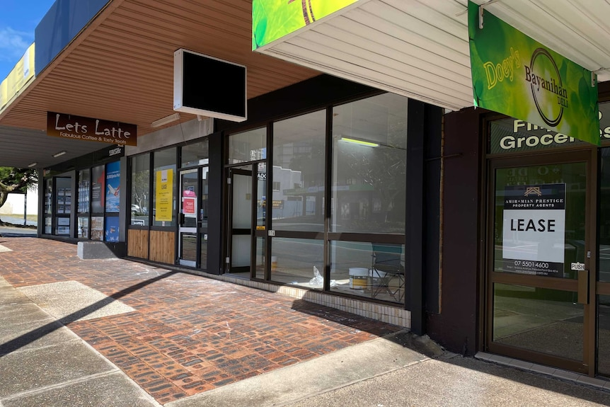 Row of empty shops in Nerang St Southport one with lease sign