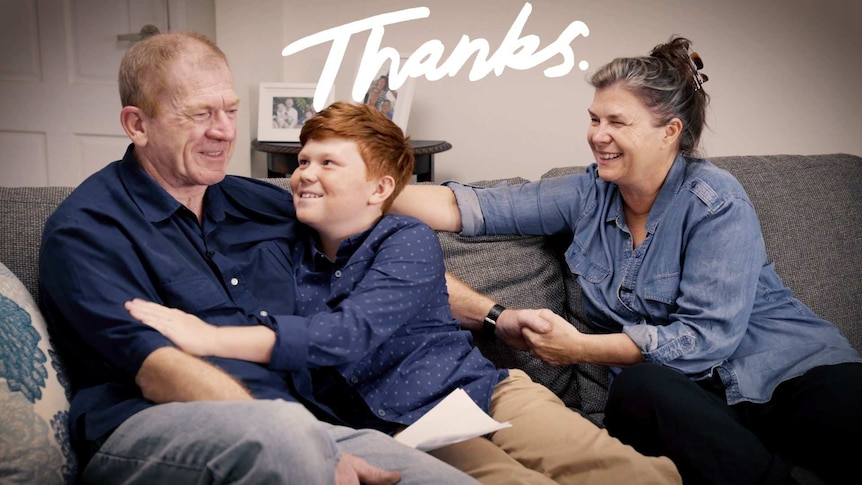 Jacob James sitting on the couch with his dad and mum with the title: Thanks to depict family life when your father has dementia