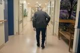 An elderly man walks down the corridor of a secure ward in Sunshine Hospital.