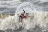 Carissa Moore surfs