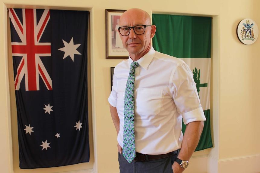 Portrait photo of Norfolk Island administrator Eric Hutchinson.