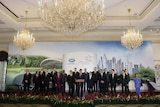 Singapore's Prime Minister Lee Hsien Loong (front row C) speaks surrounded by APEC leaders
