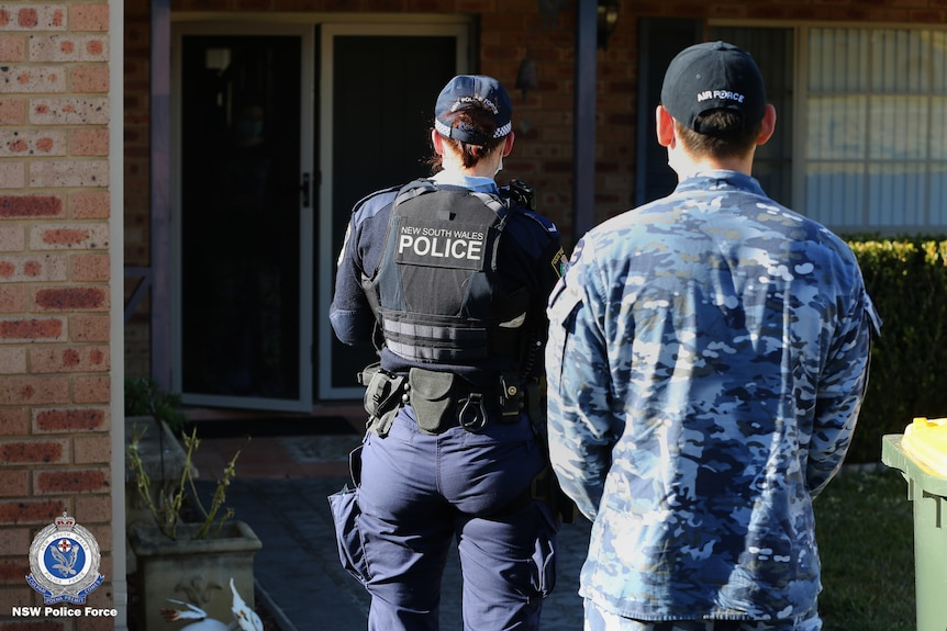 Police and Air Force officer conduct COVID compliance check