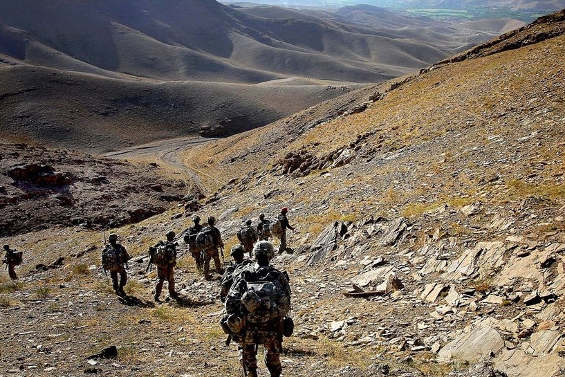 US soldiers travel down a mountain during a patrol near the Tangi Valley in Afghanistan