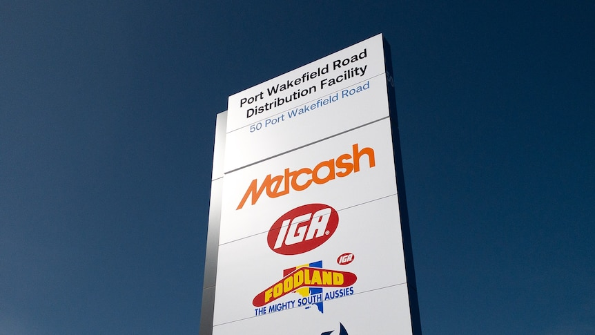 A large sign saying Metcash with other logos