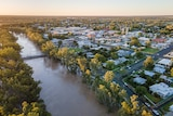 Aerial image of a river in flood and adjacent town