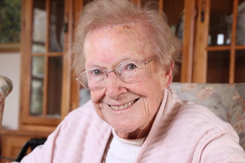 Launceston woman Joan Webb sits at her desk