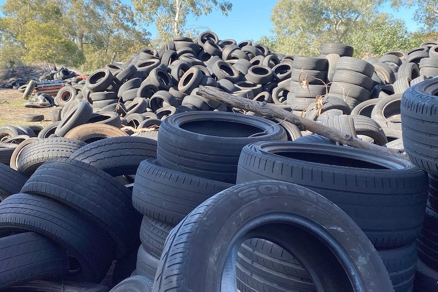 A pile of old tyres on a vacant land lot.